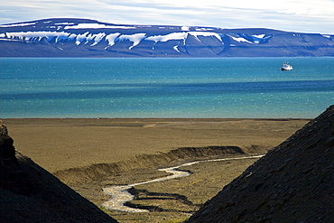 A view of the National Geographic Endeavour from the cliffs at Diskobukta on the western side of EdgeØya in the Svalbard Archipelago in the Barents Sea.