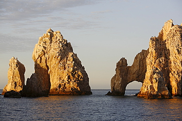 Sunrise on the famous finisterra (land's end) rock formation in Cabo San Lucas, Baja California Sur, Mexico.