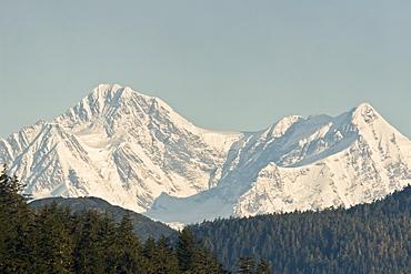 A view of the Fairweather mountain range at sunrise near Inian Pass, Southeast Alaska, USA. Pacific Ocean.