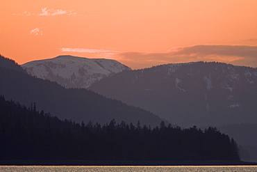 Sunset over Chichagof Island from Peril Strait in Southeast Alaska in the late springtime, USA, Pacific Ocean.