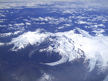 Aerial views of snow-capped mountains, ice fields, and glaciers on a charter flight from Santiago, Chile to Ushuaia, Argentina