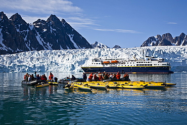 Guests from the Lindblad Expedition ship National Geographic Explorer kayaking near Monaco Glacier on Spitsbergen Island in the Svalbard Archipelago
