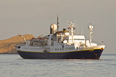 The Lindblad Expedition ship National Geographic Endeavour and its Zodiac fleet operating in the Galapagos Islands, Ecuador, Pacific Ocean.