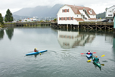 Kayaking in the slough in the small town of Petersburg in Southeast Alaska, USA. Pacific Ocean. No model or property release available for this photograph.