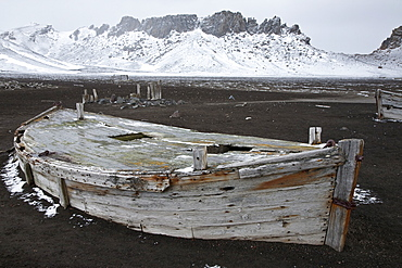 Abandoned water boat at Whalers Bay inside of the caldera at Deception Island, South Shetland Islands, Antarctica, Southern Ocean
