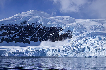 Small avalanche in Neko Harbour on the Antarctic Peninsula in Andvord Bay, Antarctica, Southern Ocean