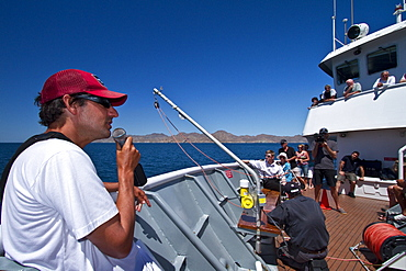 Staff member Mike Greenfelder from the Lindblad Expedition ship National Geographic Sea Bird talking with guests near the Baja Peninsula.