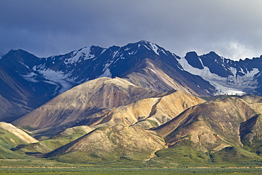 A view of the Polychrome (many-colored) Mountains from a lookout point on the park road inside Denali National Park and Preserve , Alaska, USA.