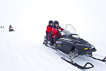 Snowmobiling on the Vatnajskull ice cap, Iceland