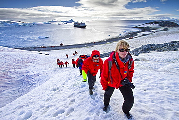 Guests from the Lindblad Expedition ship National Geographic Explorer enjoy Cuverville Island, Antarctica