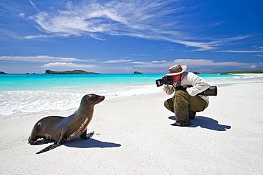 Staff (shown here is National Geographic photographer Joel Sartore) from the Lindblad Expedition ship National Geographic Endeavour in the Galapagos Islands, Ecuador