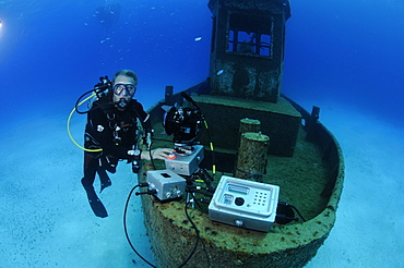 Neil Lucas with underwater time lapse system on the wreck of the 'Blue Plunder'. Bahamas.