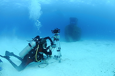 Michael pitts with underwater time lapse system on the wreck of the 'Blue Plunder'. Bahamas.