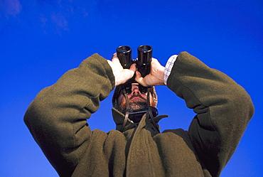 birdwatching birder at montrose basin montrose, angus, scotland