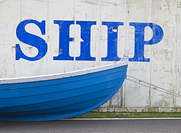 Faroese boat in front of a disused shipping container, Vagar, Faroe Islands