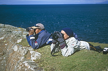 Land-based cetacean survey.  Cetacean survey work by personnel of the Hebridean Whale and Dolphin Trust.  Caliach Point, Isle of Mull, Scotland - 988-167