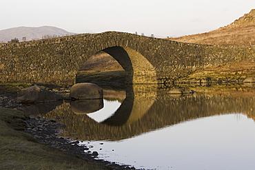 Bridge over tidal river at head of sea loch, Loch Don.  Hebrides, Scotland