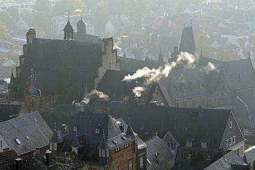 Rooftops of medieval buildings in Marburg, including Town Hall and Old University on a cold, misty autumn morning, Marburg, Hesse, Germany, Europe