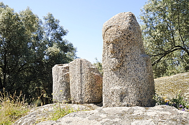 Carved Bronze Age granite statue menhirs at Filitosa, approximately 3500 years old, one intact with a grumpy face, Corsica, France, Europe