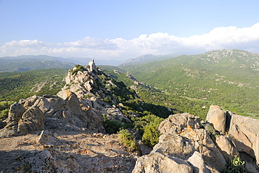Rocher du Lion granite crags and maquis scrub covered Roccapina valley, southern Corsica, France, Europe