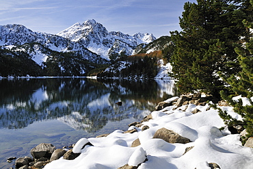 St. Maurici Lake and snowy peaks of Aigues Tortes National Park in winter, Pyrenees, Catalonia, Spain, Europe
