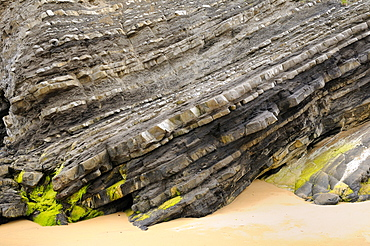Folded layers of Jurassic sedimentary limestone and marl rocks in the cliffs at Vega beach, Ribadesella, Asturias, Spain, Europe