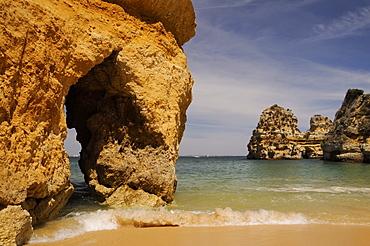 Rock archways at Praia do Camilo (Camel beach), Lagos, Algarve, Portugal, Europe