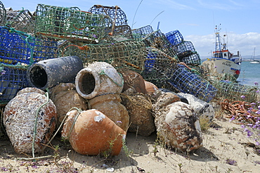 Stack of lobster pots and ceramic octopus pots on Culatra island, Parque Natural da Ria Formosa, near Olhao, Algarve, Portugal, Europe