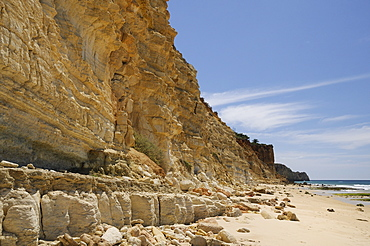 Weathered, layered sandstone cliffs at Praia do Mos, Lagos, Algarve, Portugal, Europe