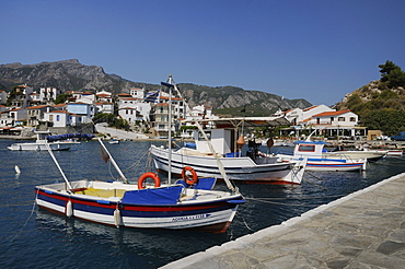 Fishing boats moored in Kokkari harbour, Samos, Eastern Sporades, Greek Islands, Greece, Europe