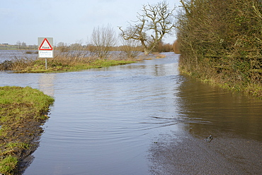Severely flooded and closed road on Curry Moor between North Curry and East Lyng after weeks of heavy rain, Somerset Levels, Somerset, England, United Kingdom, Europe