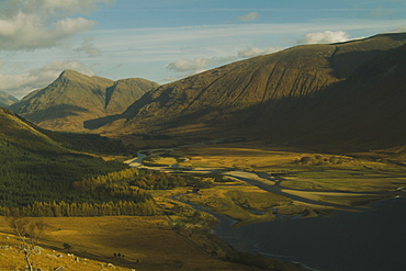 Glen Etive Valley and top of Loch Etive from high view point in Autumn featuring sun breaking through broken cloud.  , Scotland