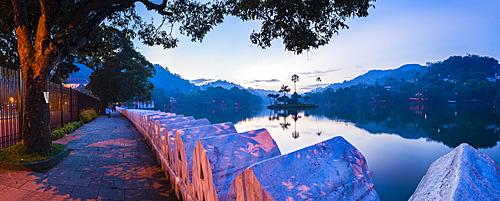 Kandy Lake and the Clouds Wall (Walakulu Wall) at sunrise, Kandy, Central Province, Sri Lanka, Asia