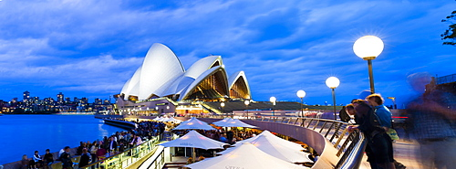 Sydney Opera House, UNESCO World Heritage Site, and people at the Opera Bar at night, Sydney, New South Wales, Australia, Pacific