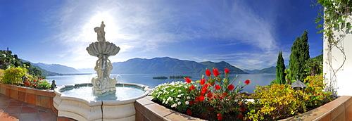 Panorama of lake Maggiore with isle of Brissago, Isole di Brissago, and Monte Gambarogno, fountain and flowers in the foreground, Ronco sopra Ascona, lake Maggiore, Lago Maggiore, Ticino, Switzerland