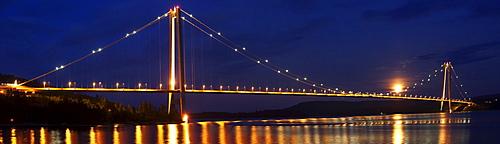 Suspension bridge Hoegakustenbron between Haernosand and Kramfors at night, 2nd longest suspensionbridge of Scandinavia, Vaesternorrland, Sweden, Europe