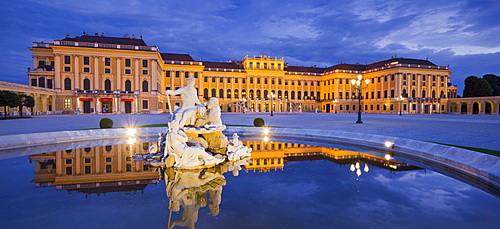 Schonbrunn palace reflected in the fountain, Hietzing, 13th district, Vienna, Austria