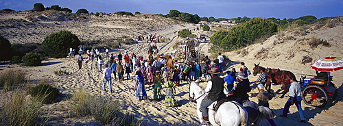 Pilgrims crossing the Donana National Park afoot and on horseback, Andalusia, Spain