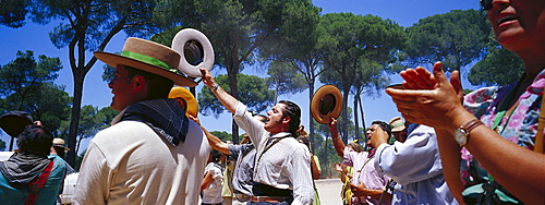 Pilgrims clapping hands and saluting on the Raya Real, Andalusia, Spain