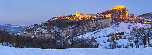 Panoramic view of the hill town San Leo and fortress on a winter evening in the province of Rimini near San Marino, Emilia-Romagna, Italy