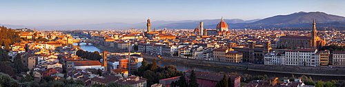 View from Piazzale Michelangelo showing the Arno Valley and Florence with the cathedral Santa Maria del Fiore and the Palazzo Vecchio in the morning sunlight, Tuscany, Italy