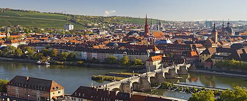 View from Marienberg fortress over Wuerzburg, Alte Mainbruecke bridge and river Main, Neumuenster Kollegiatstift, St Kilian's cathedral, Wuerzburg, Bavaria, Germany