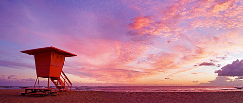 Hawaii, Kauai, Salt Ponds Beach, Lifeguard tower at sunset.