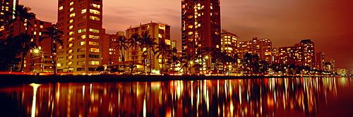 Hawaii, Oahu, Waikiki at dusk, Glow of city lights on Ala Wai Canal.