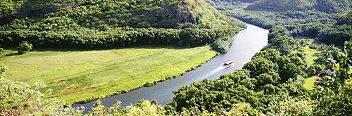 Hawaii, Kauai, aerial view of Wailua River with tour boat, greenery, panoramic