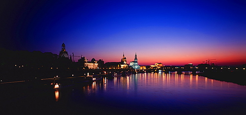 Old part of Dresden at night, view over Elbe river, Bruhl Terrace with castle, Court church and Semper opera house, Saxony, Germany / Bruhlsche Terasse