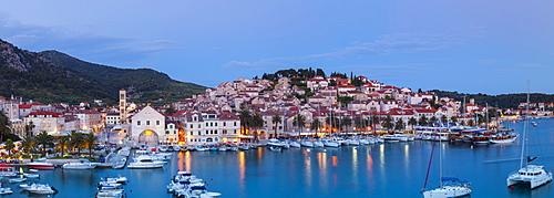 Elevated view over the picturesque harbour town of Hvar illuminated at dusk, Hvar, Dalmatia, Croatia, Europe - 1158-460