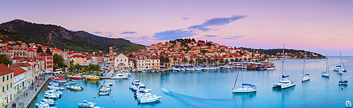 Elevated view over the picturesque harbour town of Hvar illuminated at dusk, Hvar, Dalmatia, Croatia, Europe - 1158-482