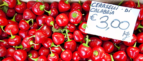 Pimento peppers, Ceraselli di Calabria, on sale at weekly street market in Panzano-in-Chianti, Tuscany, Italy