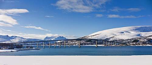 Arctic landscape Sandnesundbrua Bridge joining Kvaloya Island and Tromsoya Island at Tromso in Arctic Circle, Northern Norway